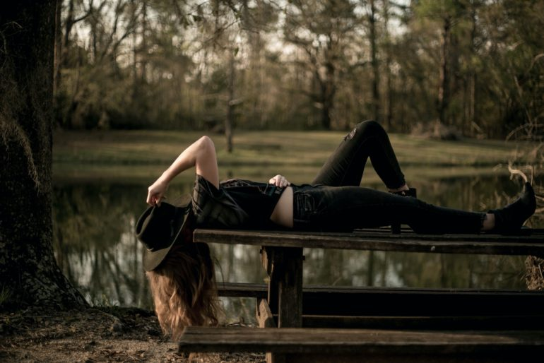 Girl laying on picnic table