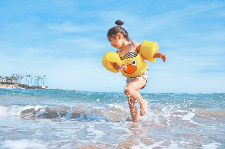 Child playing at the beach