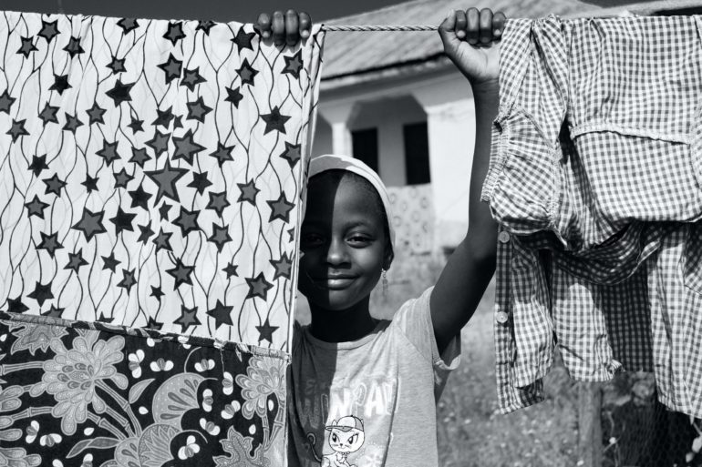 Child with clothesline
