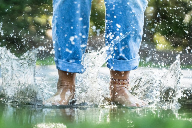 Feet splashing in water