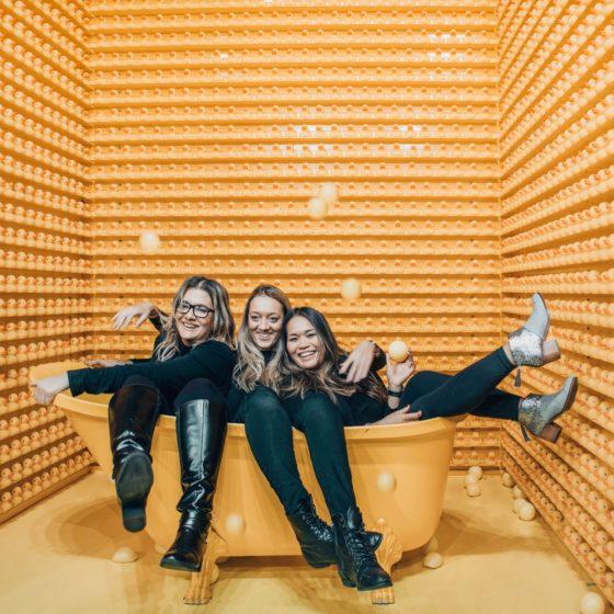 Friends in orange room