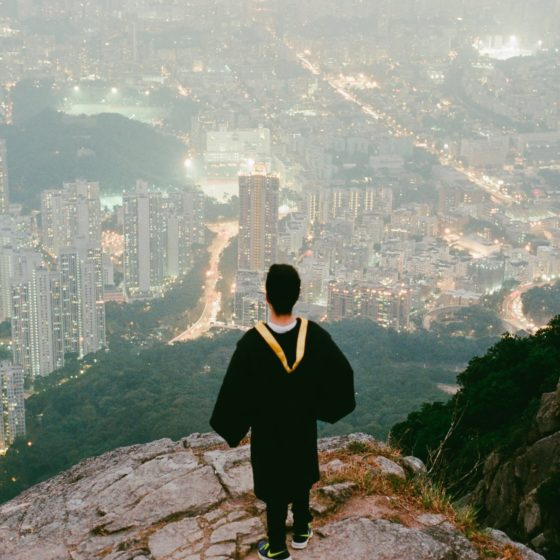 Graduate looking at city
