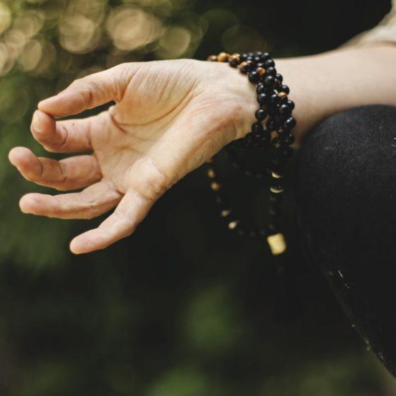 Hand in meditation position