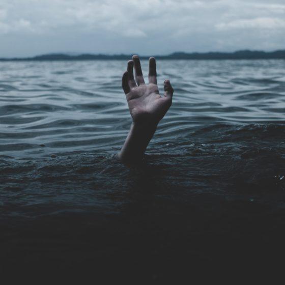 Hand reaching from underwater